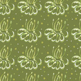 Green seamless background with flowers. Stock Photos