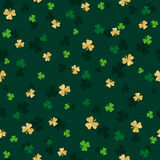Green  seamless background for Patricks day with golden shamrock Stock Photography