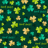 Green  seamless background for Patricks day with golden shamrock Stock Photo