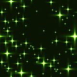 Green seamless background with shining stars. Royalty Free Stock Image
