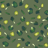 Green seamless pattern of broccoli bell pepper and. Green background seamless pattern of vegetables broccoli cucumber leek pepper scattered in disarray Stock Images
