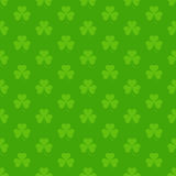 Green seamless pattern with Saint Patricks shamrock symbols Stock Photography