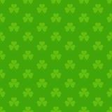 Green seamless pattern with Saint Patricks shamrock symbols Stock Photography