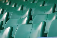 Green Seat. Empty seats in green color in the sport center Stock Images