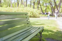 Green seat on a park Stock Image