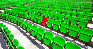 Green seat rows. With only one red Stock Photos