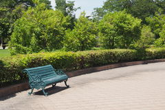 Green seating bench. In the garden Royalty Free Stock Images