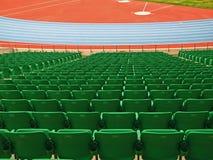 Green seats. Of a bleacher at a stadium Stock Image
