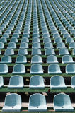 Green seats for spectators in the stadium. Seats for spectators in the stadium located in the geometric pattern Royalty Free Stock Images