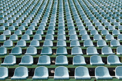 Green seats for spectators in the stadium. Seats for spectators in the stadium located in the geometric pattern Royalty Free Stock Photo