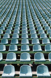 Green seats for spectators in the stadium. Seats for spectators in the stadium located in the geometric pattern Stock Images