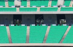 Green seats sports stadium Royalty Free Stock Photo