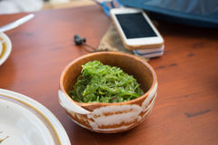 Green seaweed in ceramic bowl , Thai dish table Stock Photography