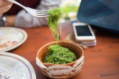 Green seaweed in ceramic bowl , Thai dish table Royalty Free Stock Photo