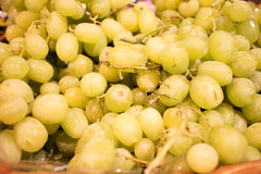 Green seedless grapes at market Stock Images