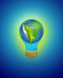 Green seedling with water & earth in light bulb on blue Royalty Free Stock Photos