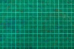 Green self-healing cutting mat close up Royalty Free Stock Photos