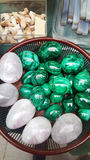 Green semi precious mineral stones in egg shape. Egg shaped  semi precious gemma stones Stock Image