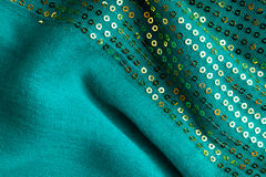 Green sequine background texture abstract cloth wavy folds textile Stock Photo