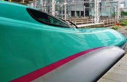 A green Series E5 Shinkansen high-speed bullet train Royalty Free Stock Photo