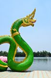 Green Serpent  statue in temple Thailand Stock Photography