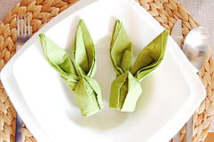 Green servette bunnies. Two green servette bunnies table decoration on a white plate Stock Photography