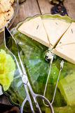 Green serving glass plate with rosemary shortbread on wooden tab Stock Photos