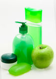 Green set for a bath. Soap, shampoo, gel, apple, on white background Stock Image