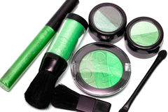 Green set for make-up. Eyeshadows, rouge, blusher and gloss Royalty Free Stock Images