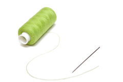 Green sewing and steel needle Royalty Free Stock Photo
