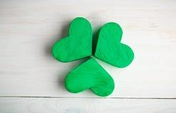 Green shamrock clovers on white wooden background Stock Image