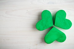 Green shamrock clovers on white wooden background Royalty Free Stock Photo