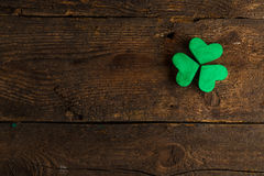 Green shamrock clovers on wooden background Stock Photography