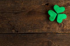 Green shamrock clovers on wooden background Stock Images
