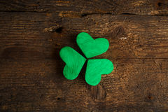 Green shamrock clovers on wooden background Royalty Free Stock Photo