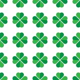 Green shamrock seamless pattern. Background of fourleaf clovers. Simple flat vector illustration.  stock illustration