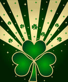 Green shamrocks. And stars with golden rays Stock Photo