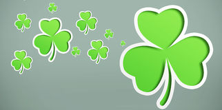 Green shamrocks on grey background. Different sized shamrocks on grey background Stock Image