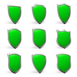 Green shields on white set Stock Photos