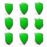Green shields on white set Stock Photos