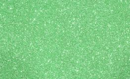 Green shimmering glittered background with lights Royalty Free Stock Image