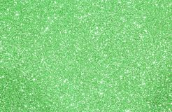 Green glittered background with glittering lights and reflection Royalty Free Stock Photo