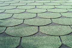 Green shingle roof style background