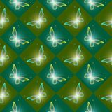 Green shiny background with butterflies. Glowing background with magic  butterflies and sparkling stars. Beautiful seamless pattern Royalty Free Stock Images