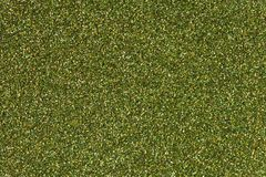 Green shiny background. Glitter texture on macro. royalty free stock photography