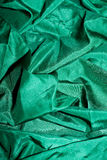Green shiny silk. Background made of wrinkled green shiny silk Royalty Free Stock Photos