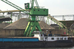 Green ship crane. In a river harbor in Holland loading san form a rivership royalty free stock image
