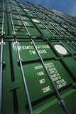 Green Shipping Containers stacked on one another Royalty Free Stock Image