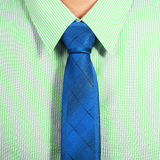 Green shirt with blue necktie Stock Photo