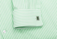 Green shirt collar and cuff links Stock Photos